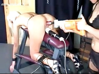 Blonde Girl Tied To Platform In Doggy Fucked hard With Fuck Saw Clit Stimulated With Vibrator By