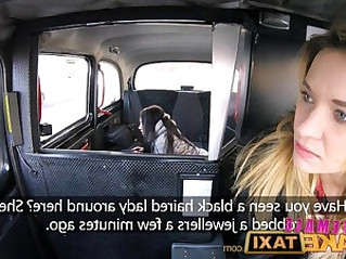 Female Fake Taxi Pretty brunette has first lesbian with strap on cock